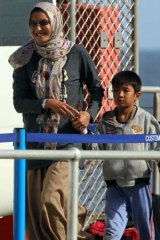 Happy to be here ... Malaysia deal asylum seekers arrive on Christmas Island.