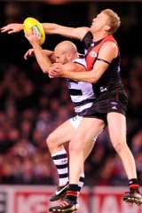 Stretching out: Geelong's Paul Chapman attempts to mark in front of Dustin Fletcher last night.