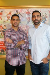 Working together: Sydney Swans players Adam Goodes and Michael O'Loughlin.
