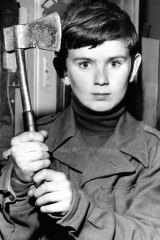 Shane Spiller with his tomahawk. The youngster had been walking along the beach with friend Yvonne Tuohy, 12, when she was snatched and brutally murdered by Derek Percy.