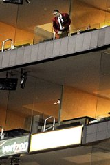 A security guard looks down from the balcony where a toddler fell at an LA Lakers NBA game.