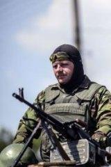 A Ukrainian soldier near Donetsk on top a humvee with a Ukrainian flag behind him on Thursday.
