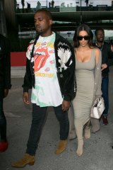 Kanye (with wife Kim Kardashian) in a Rolling Stones T-shirt in Paris in June.