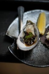 Coffin Bay oyster with fly fish pearls and negi, served at Hako.