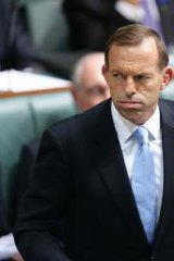 Tony Abbott: Denies the government is backing away from a pre-election commitment.