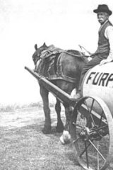 Cocky Robinson on a Furphy water cart on Furphy's farm in about 1900.