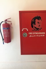 A stencil of the Emir's face on a fire extinguisher cabinet in Souq Waqif, Doha.