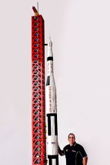 Australia's only certified Lego professional, Ryan McNaught, stands next to the 5.6-metre tall Lego rocket.