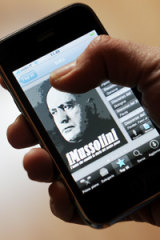 An Apple's Iphone user shows an application from the Italian Itunes store called IMussolini.