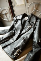 A leather jacket studded with silver buckles and zips that was worn by Bon Scott.