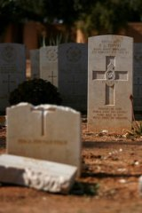 Damaged headstones of Commonwealth soldiers at the Benghazi War Cemetery in Libya.
