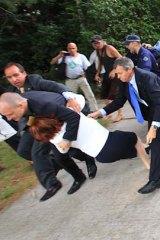 Not quite Cinderella ... Julia Gillard evades protesters.