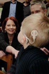 The Prime Minister, Julia Gillard, jokes with Ben Baulch when she visited the Taralye Kindergarten for Deaf Children in Blackburn, Melbourne, yesterday.