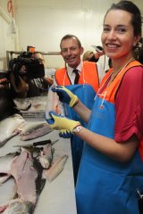 Hooked . . . Tony Abbott and his daughter Louise.