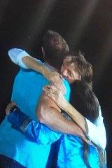 McCartney embraces engaged couple.