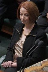 Julia Gillard listens to Mr Abbott's attack.