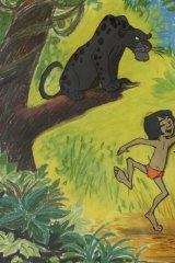 Bagheera watches Mowgli and Baloo dance in Disney's <i>The Jungle Book</i>  from 1967.