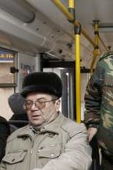 Alert: A Cossack patrols a bus in central Volgograd. Authorities are said to suspect ethnic Russian converts to Islam may be behind the suicide bombings.