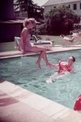 A dream-like domesticity is captured in this photograph of a pool party in 1950s California.