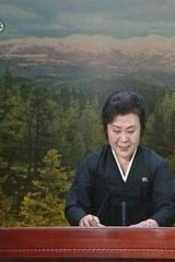 A tearful announcer dressed in black announces the death of North Korean leader Kim Jong-il on North Korean State Television in this still image from video December 19, 2011.