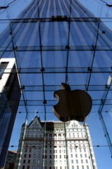 The entrance to the Apple store is shown on New York's Fifth Ave. Photo: AP/Mark Lennihan