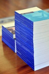 The 17 volumes of the royal commission's final report, delivered on Friday.