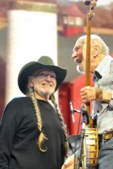 Pete Seeger and Willie Nelson on stage during the Farm Aid 2013 concert at Saratoga Performing Arts Center in Saratoga Springs, N.Y.