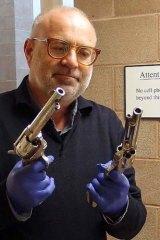 Idol: Dr Derham Groves with Hopalong's guns.