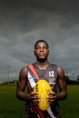 Kicking on: Sudanese refugee Patrick Taban now plays for the NT Thunder Under-18s AFL side.