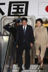 The first Japanese leader to address Australia's Parliament: Prime Minister Shinzo Abe, left, and his wife Akie Abe arrive in Canberra on Monday night.