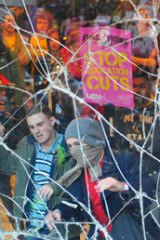 Demonstrating students clashed with police and broke windows at the headquarters of the Conservative Party in London.