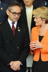 Grin and bear it: Foreign ministers Marty Natalegawa and Julia Bishop at the opening of the Bali Democracy Forum in Bali on Thursday.