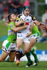 Panthers veteran Jamie Soward is rounded up by the Raiders.