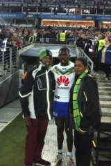 Raiders debutant Edrick Lee with his parents Samuel Lee and Connie Blankett at ANZ Stadium last Friday.