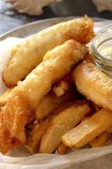 Fish and chips with tartare sauce.
