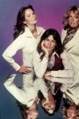 Charlie calling: The three angels always listen to the boss man's gentle booming voice.