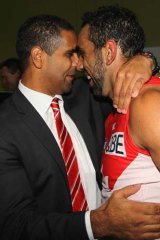 Time to celebrate ... Adam Goodes, right, with former Sydney games record holder MIchael O'Loughlin after the game.