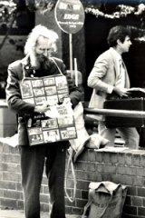 Relentless . . . fred cole selling posters outside Burwood court.