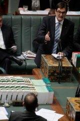 Greg Combet gestures towards Tony Abbott during a parliamentary debate in 2011.