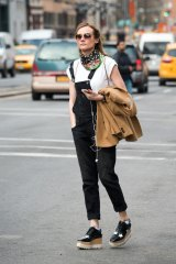 Industrial evolution ... Diane Kruger matches her overalls with a platform lace-up.