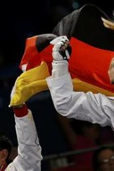 The victor ... Germany's Helena Fromm celebrates her bronze medal.