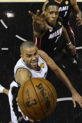 Global appeal: San Antonio Spurs guard Tony Parker shoots as Miami Heat's Mario Chalmers defends during the NBA Finals in June.