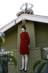 A mannequin portraying Sarah Palin hangs by a noose, while a mannequin portraying John McCain protrudes from the chimney of a house in West Hollywood.
