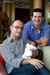 Darren and John Allen-Drury, with their son, Noah, who was born in India to a surrogate.