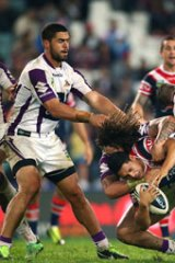 Cooper Cronk and Kevin Proctor of the Storm up end Mahe Fonua of the Roosters during the round 11 NRL match between the Sydney Roosters and the Melbourne Storm at Allianz Stadium on May 25, 2013 in Sydney, Australia.