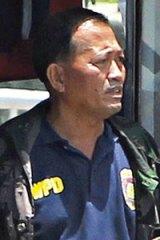 Demanding his job back ... Rolando Mendoza.