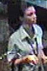 Police are looking for a woman who cashed a winning TAB ticket after a Banyo home invasion.