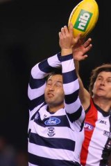 Jimmy Bartel of the Cats and Farren Ray of the Saints compete for the ball.