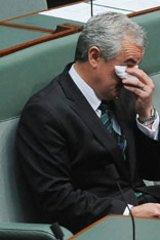 Independent Andrew Wilkie wipes away tears after concluding his anti Afghanistan war speech.