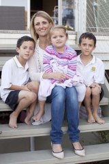 Making it happen: mums@work founder Emma Walsh at home with her children, Ewan, Alice and Luc.